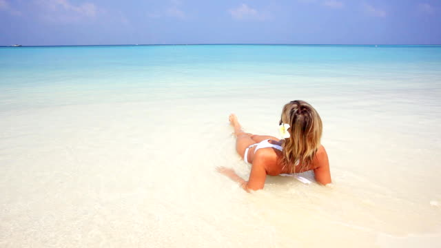 Woman relaxing and sunbathing on the Maldivian beach. video