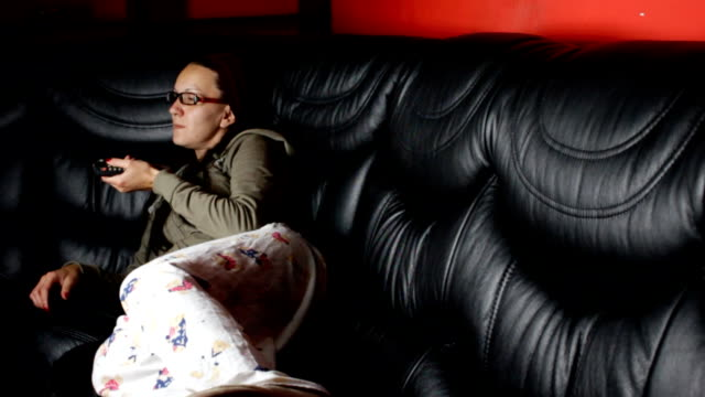 Woman relaxing and watching tv video