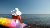 Woman relaxing at the beach video