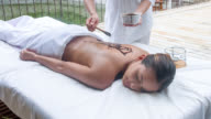 Woman relaxing at the spa video