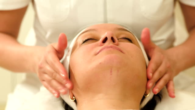 Woman relaxing during facial therapy ar beauty spa video