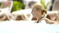 Woman relaxing in hot tub outdoors video