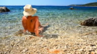 HD DOLLY: Woman Relaxing In Shallow Water video