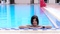 woman relaxing in the swimming pool of the hotel resort during holidays video