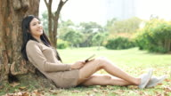 Woman Relaxing Listening to Music in Park, Relaxation video