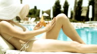 Woman relaxing near the waterpool with cream video