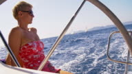 SLO MO Woman relaxing on a sailing boat video
