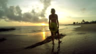 Woman relaxing on the beach. Freedom and harmony in nature. Sunset video