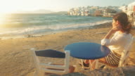 Woman relaxing on the beach in Mikonos town - Greece. video