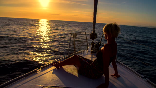 LS Woman Relaxing On The Bow At Sunset video