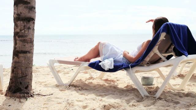 Woman relaxing on tropical island video