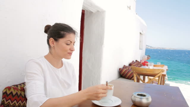 Woman relaxing while drinking her coffee. video