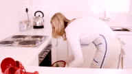 Woman removing cookies from the oven video
