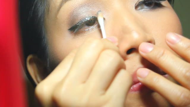 woman removing eye make-up video