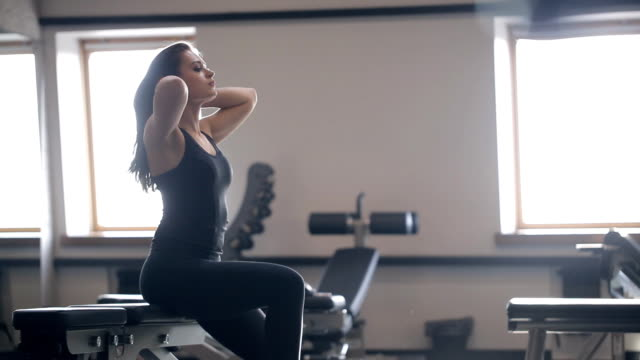 Woman resting after workout at trainers inside gym video