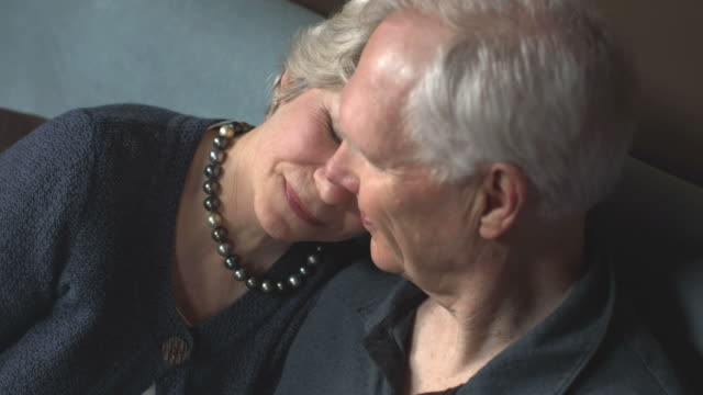 Woman rests her head on husbands shoulder. video