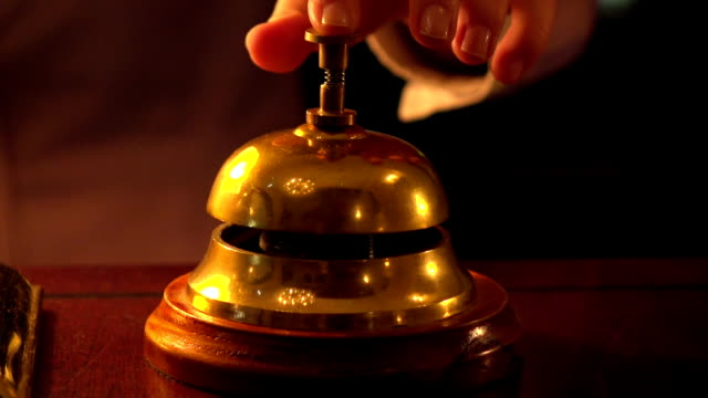 Woman ringing hotel reception bell video