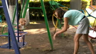 Woman rocking my daughter on the swing video