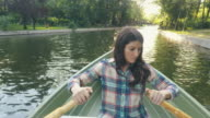 Woman rowing in a beautiful sunny day. video