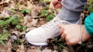 Woman Runner Tying Shoelace In the Nature video