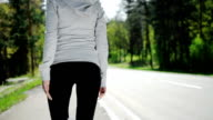 SLOW MOTION woman runner warm up outdoor video