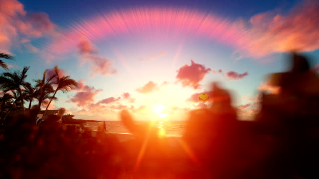 Woman runnin on the beach, air ballon and yacht sailing against beautiful sunset video