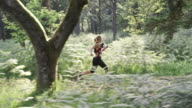 SLO MO DS Woman running a forest trail marathon video