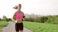 SLO MO TS Woman running and listening to music video