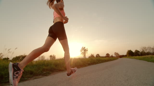 SLO MO TS TU Woman running as sun is setting video