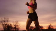 SLO MO TS Woman running as the sun is setting video