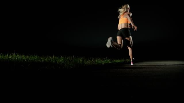 SLO MO PAN Woman running at night video