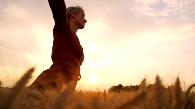 HD SUPER SLOW-MOTION: Woman Running In Field At Sunset video