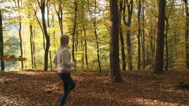 HD SLOW MOTION STEADY SHOT: Woman Running In Forest video