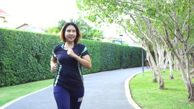 woman running  in public park video