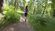 TS Woman running in the forest on sunny day video