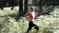 SLO MO DS Woman running in forest video