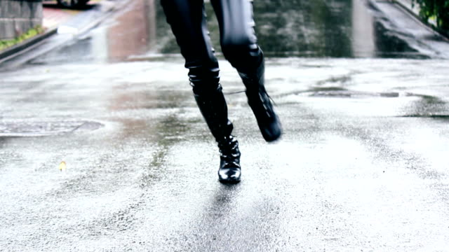 Woman Running in the rain.Selective Focus. video