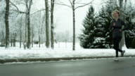 Woman running in the winter video