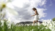 SLOW MOTION: Woman running in white flower field video
