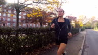Woman Running near Park in the Autumn video