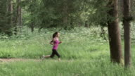 SLO MO DS Woman running on forest trail video