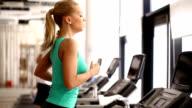 Woman running on a treadmill. video