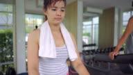 Woman running on a treadmill video