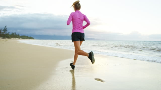 Woman Running on the Beach video