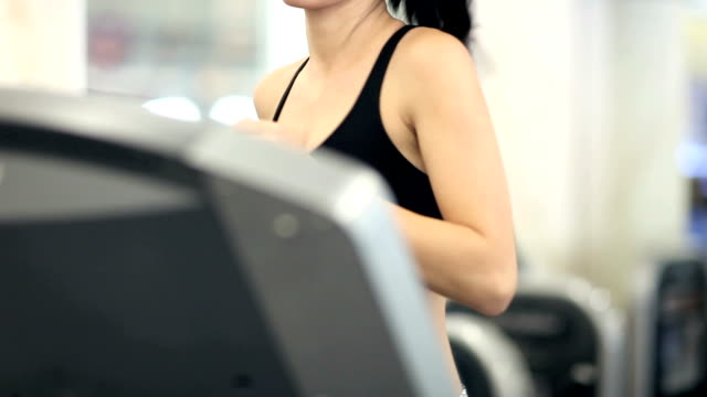 Woman Running on Treadmill - 1080p video