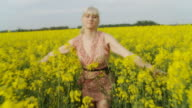 HD SLOW MOTION: Woman Running Through Field With Arms Outstretched video