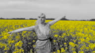 HD SLOW MOTION: Woman Running Through Field With Open Arms video