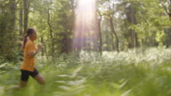 TS Woman running through forest video