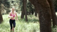 SLO MO DS Woman running through forest video