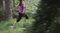 SLO MO DS TU Woman running in forest video